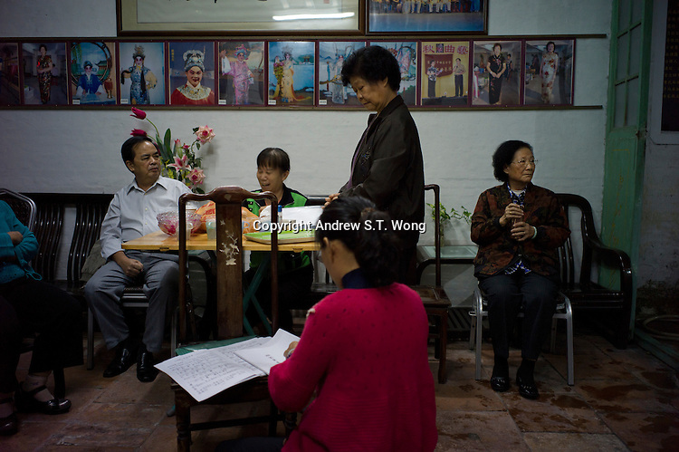 Amateur singers of the Huang Cantonese Opera group discuss during practice at their ancestral temple at Yanbu Village in Nanhai district of Foshan city, Guangdong province, November 8, 2011.