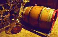 The Disznoko winery in Tokaj: In the cellar, a wooden barrel and a demijohn with Tokaj Eszencia. The Disznók? winery is owned by AXA Millesimes, a French insurance company. Disznoko means pig's head since a big rock in the vineyard supposedly looks like that. The new winery is impressive and a vast amount of money has been invested. Credit Per Karlsson BKWine.com