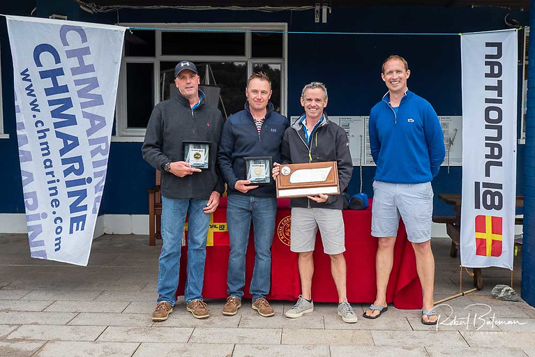 Four-time National 18 championships winner - Ewan Barry (with trophy) and crew Dion Barrett (left) and Stan Brown pictured with class captain Charles Dwyer (right)