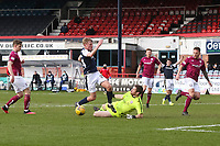 13th March 2021; Dens Park, Dundee, Scotland; Scottish Championship Football, Dundee FC versus Arbroath; Arbroath goalkeeper Derek Gaston saves at the feet of Max Anderson of Dundee