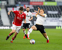 7th November 2020; Pride Park, Derby, East Midlands; English Football League Championship Football, Derby County versus Barnsley; Krystian Bielik of Derby County stretches for the ball as Dominik Frieser of Barnsley steps in to tackle