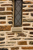 Close up photo showing the stone and mortar work on a home in the Myers Park neighborhood in Charlotte, NC. Myers Park is one of the premier neighborhoods in North America and known for its large canopy of trees.