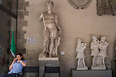 Attendant and sculptures in the Bargello Gallery, Florence, Italy