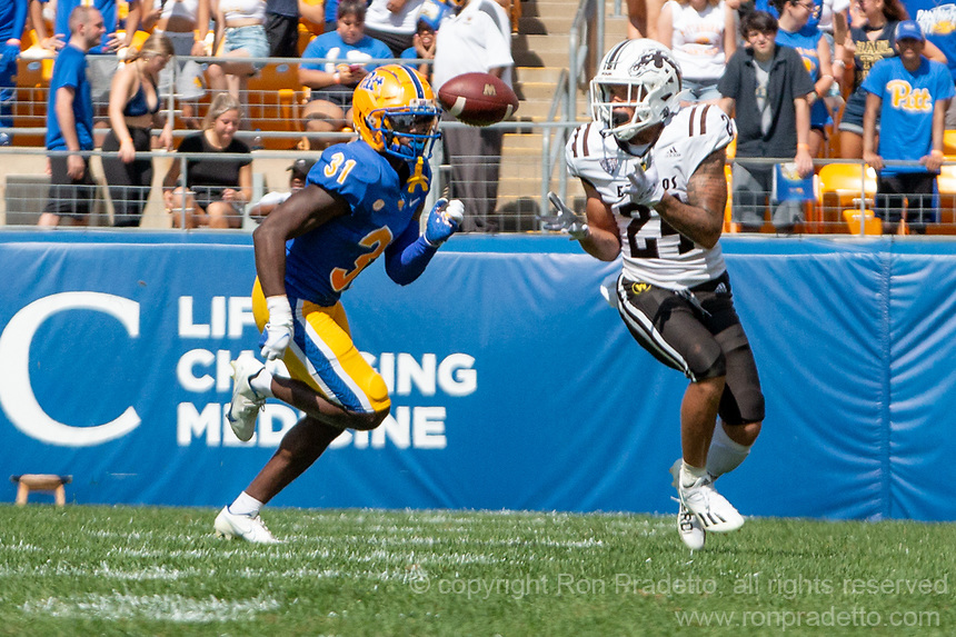 WMU wide receiver Skyy Moore (24) makes a catch while being pursued by Pitt defensive back Erick Hallett (31). The Western Michigan University Broncos defeated the Pitt Panthers 44-41 at Heinz Field, Pittsburgh, Pennsylvania on September 18, 2021.