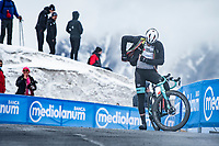 Christopher Juul-Jensen (DEN/BikeExchange) stopping up the Passo Giau, prepping properly for the descent<br /> <br /> due to the bad weather conditions the stage was shortened (on the raceday) to 153km and the Passo Giau became this years Cima Coppi (highest point of the Giro).<br /> <br /> 104th Giro d'Italia 2021 (2.UWT)<br /> Stage 16 from Sacile to Cortina d'Ampezzo (shortened from 212km to 153km)<br /> <br /> ©kramon