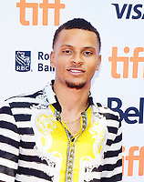04 August 2021 - Canada's Andre De Grasse wins gold in the men's 200-metre sprint at the Tokyo Olympics.  De Grasse's win marks the first time a Canadian has won the event since 1928.  File Photo: TIFF 2017, Toronto, Ontario, Canada. Photo Credit: Brent Perniac/AdMedia