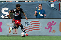 FOXBOROUGH, MA - AUGUST 8: Tajon Buchanan #17 of New England Revolution dribbles down the wing during a game between Philadelphia Union and New England Revolution at Gillette Stadium on August 8, 2021 in Foxborough, Massachusetts.