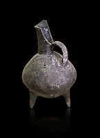 Bronze Age pitcher in terra cotta. 3200-1900 BC from Beycesultan. Hierapolis Archaeology Museum, Turkey . Against an black background