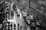 London 1970s Victoria Street. Evening rush hour, people, taxis, car and buses dark and wet as commuters make their way home. 1976 UK