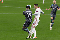 ST PAUL, MN - SEPTEMBER 27: Romain Metanire #19 of Minnesota United FC with the header during a game between Real Salt Lake and Minnesota United FC at Allianz Field on September 27, 2020 in St Paul, Minnesota.
