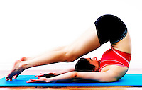 Beautiful female streching on a fitness mat