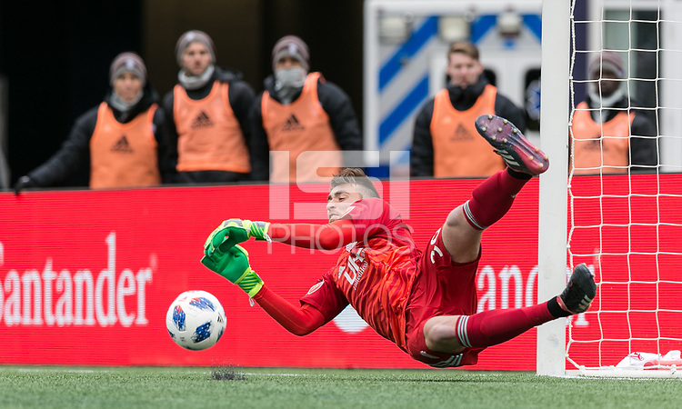 Foxborough, Massachusetts - March 10, 2018: In a Major League Soccer (MLS) match, New England Revolution (blue/white) defeated Colorado Rapids (yellow/blue), 2-1, at Gillette Stadium.<br /> Penalty kick save.