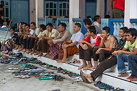 Borobudur, Java, Indonesia.  Young Men Waiting for Friday Noon Prayers at a Neighborhood Mosque.