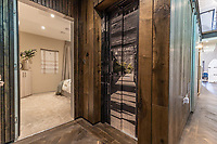 BNPS.co.uk (01202) 558833. <br /> Pic: LuxuryAndPrestige/BNPS<br /> <br /> Pictured: Lift by master bedroom entrance. <br /> <br /> A heavenly converted chapel that has been transformed into a contemporary home is on the market for £1.5m.<br /> <br /> The Old Chapel was used by an order of nuns for 139 years before the humble church got a stylish upgrade into a four-bedroom property.<br /> <br /> The Grade II listed building has been carefully restored to retain stunning ecclesiastical features like windows, archways and doors, but with a modern twist.<br /> <br /> And although the owner bought it from the developer before it was finished, the stunning home has never been lived in.
