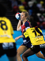 23 NOV 2011 - LONDON, GBR - Britain's Nina Heglund (in blue and red) prepares to pass during the 2011 London Handball Cup match against Angola at The Handball Arena in the Olympic Park in Stratford, London  (PHOTO (C) NIGEL FARROW)