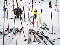 """Switzerland. Canton Valais. Si tourists in Verbier at  """" La Chaux"""" ( 2260 meters ). Verbier is a village located in the municipality of Bagnes in the Val de Bagnes. Verbier is one of the largest holiday resort and ski areas in the Swiss Alps. Ski poles and skis. 3.01.2012 © 2012 Didier Ruef"""