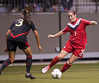 Rhian Wilkinson, right of Canada dribbles the ball in front of Marlene Sandoval of Mexico in the CONCACAF Olympic Qualifying semifinal match at BC Place in Vancouver, B.C., Canada Friday Jan. 27, 2012. Canada won the match 3-1 to earn a berth in 2012 London Olympics.