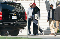 NOV 14 The motorcade carrying U.S. President Donald J. Trump drives through a rally of Trump support