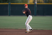 AZL Giants Black second baseman Marcos Campos (15) prepares to make a throw to first base during an Arizona League game against the AZL Athletics at the San Francisco Giants Training Complex on June 19, 2018 in Scottsdale, Arizona. AZL Athletics defeated AZL Giants Black 8-3. (Zachary Lucy/Four Seam Images)