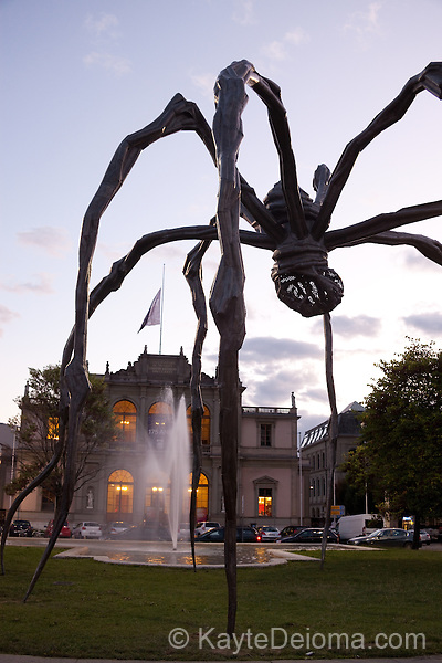 """A giant bronze spider, """"Maman"""" by Louise Bourgeois on temporary display in front of the Music Conservatory at Place Neuve in Geneva, Switzerland"""