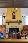 Living room with a fireplace, chandelier, and table. California