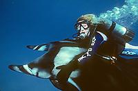 woman scuba diver riding manta ray, Manta birostris, Cocos Island, Costa Rica, Pacific Ocean, MR