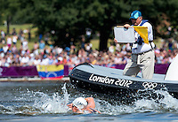 09 AUG 2012 - LONDON, GBR - Technical Official Jorge Delgado Panchana gives a competitor a warning during the London 2012 Olympic Games women's 10km Marathon Swimming in Hyde Park, London, Great Britain (PHOTO (C) 2012 NIGEL FARROW)