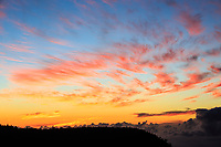 Sunset creates a brilliantly colored sky over the Pu'u o Kila Lookout and the Pihea Trail, Kaua'i.