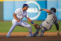 Round Rock Express shortstop Guilder Rodriguez (1) attempts to tag Salt Lake Bee base runner Scott Cousins (5) at second base during the Pacific Coast League baseball game on August 10, 2013 at the Dell Diamond in Round Rock, Texas. Round Rock defeated Salt Lake 9-6. (Andrew Woolley/Four Seam Images)