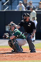 Umpire Mike Trotter makes a call during behind catcher John Rooney (4) a game between the Siena Saints and Central Florida Knights at Jay Bergman Field on February 16, 2014 in Orlando, Florida.  UCF defeated Siena 9-6.  (Mike Janes/Four Seam Images)
