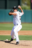 Phoenix Desert Dogs pitcher Michael Brady #22, of the Miami Marlins organization, during an Arizona Fall League game against the Surprise Saguaros at Phoenix Municipal Stadium on October 18, 2012 in Phoenix, Arizona.  The game was called after eleven innings with a 2-2 tie.  (Mike Janes/Four Seam Images)