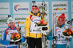 MARTELL-VAL MARTELLO, ITALY - FEBRUARY 02: Flower ceremony after the Women 7.5 km Sprint at the IBU Cup Biathlon 6 on February 02, 2013 in Martell-Val Martello, Italy. (L-R) 2nd ZAGORUIKO Anastasia (RUS), 1st HORCHLER Karolin (GER) and 3rd BONDAR Iana (UKR). (Photo by Dirk Markgraf)