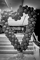 United Arab Emirates (UAE). Dubai. Gateway Hotel. Leftover from Valentine's day, a heart made of inflated balloons. On the lobby's wall, various portraits of Dubai's rulers, the family from Sheik Mohammed bin Rashid Al Maktoum. The Al Maktoum family is the ruling royal family of Dubai, and one of the six ruling families of the United Arab Emirates. The family is a branch of the Bani Yas clan. The United Arab Emirates (UAE) is a country in Western Asia at the northeast end of the Arabian Peninsula. 15.02.2020  © 2020 Didier Ruef