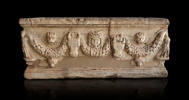 Roman relief sculpted garland sarcophagus, 3rd century AD. Adana Archaeology Museum, Turkey. Against a black background