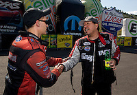Jul. 21, 2013; Morrison, CO, USA: NHRA Bob Tasca III (left) congratulates funny car driver Cruz Pedregon who celebrates after winning the Mile High Nationals at Bandimere Speedway. Mandatory Credit: Mark J. Rebilas-