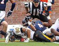 Southern Miss Golden Eagles wide receiver Ryan Balentine (80) slides in for touchdown under Virginia Cavaliers safety Rodney McLeod (4) during the game at Scott Stadium. Virginia lost to Southern Mississippi 30-24. (Photo/Andrew Shurtleff)