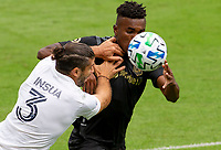 LOS ANGELES, CA - OCTOBER 25: Jose Cifuentes #11 of LAFC and Emiliano Insua #3, of the Los Angeles Galaxy battle during a game between Los Angeles Galaxy and Los Angeles FC at Banc of California Stadium on October 25, 2020 in Los Angeles, California.
