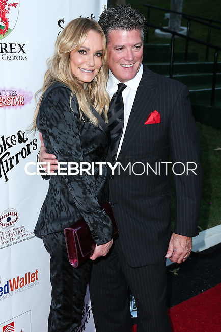 BEVERLY HILLS, CA, USA - SEPTEMBER 13: Taylor Armstrong, John Bluher arrives at the Brent Shapiro Foundation For Alcohol And Drug Awareness' Annual 'Summer Spectacular Under The Stars' 2014 held at a Private Residence on September 13, 2014 in Beverly Hills, California, United States. (Photo by Xavier Collin/Celebrity Monitor)
