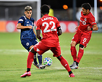 LAKE BUENA VISTA, FL - JULY 26: Jesús Medina of New York City FC passes the ball while defended by Marco Delgado of Toronto FC and Richie Laryea of Toronto FC during a game between New York City FC and Toronto FC at ESPN Wide World of Sports on July 26, 2020 in Lake Buena Vista, Florida.