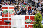 August 08, 2009: Geoff Billington (GBR) salutes the crowd after his mount Cassius Clay II refused to jump the wall. Land Rover International Puissance. Failte Ireland Horse Show. The RDS, Dublin, Ireland.