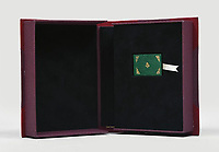 BNPS.co.uk (01202) 558833<br /> Pic: PeterHarrington/BNPS<br /> <br /> It measures just 1.5ins by 2.5ins<br /> <br /> A unique miniature Harry Potter book created by JK Rowling has emerged for sale for £125,000.<br /> <br /> The author hand-wrote and illustrated the 31 page green leather bound manuscript measuring just 1.5ins by 2.5ins for a charity auction in 2004.<br /> <br /> It contains the passage on pages 52-53 of Harry Potter and The Philosopher's Stone where Harry and Hagrid go to London to buy school supplies for Hogwarts.<br /> <br /> Rowling has done original drawings of equipment including quills, scales, a cauldron and a wizard's hat.
