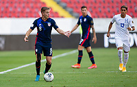 GUADALAJARA, MEXICO - MARCH 28: Djordje Mihailovic #8 of the United States looking for help during a game between Honduras and USMNT U-23 at Estadio Jalisco on March 28, 2021 in Guadalajara, Mexico.