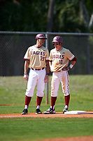 Boston College Eagles left fielder Michael Strem (10) talks with third base coach Alex Trezza (39) during a game against the Central Michigan Chippewas on March 3, 2017 at North Charlotte Regional Park in Port Charlotte, Florida.  Boston College defeated Central Michigan 5-4.  (Mike Janes/Four Seam Images)