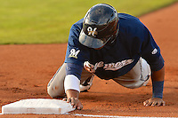 Dionis Hinojosa (27) of the Helena Brewers dives back to first base in action against the Ogden Raptors at Lindquist Field on July 23, 2013 in Ogden Utah. (Stephen Smith/Four Seam Images)