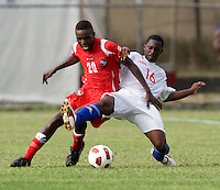 Javier Aquilar (16) of Cuba fights for the ball with Alexander Gonzalez (20) of Panama during the group stage of the CONCACAF Men's Under 17 Championship at Jarrett Park in Montego Bay, Jamaica. Panama tied Cuba, 0-0.
