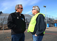 Feb 4, 2016; Chandler, AZ, USA; NHRA team owner Don Schumacher (left) talks with photographer Richard Shute during pre season testing at Wild Horse Pass Motorsports Park. Mandatory Credit: Mark J. Rebilas-USA TODAY Sports
