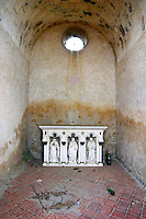 Inside the Hermitage chapel on the Hermitage hill, a small altar and some empty bottles and other rubbish. Tain l'Hermitage, Drome, Drôme, France, Europe