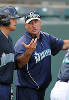 Coach Rafael Santo Domingo (40) of the Pulaski Mariners in a game against the Danville Braves on July 19, 2010, at Calfee Park in Pulaski, Va. Photo by: Tom Priddy/Four Seam Images