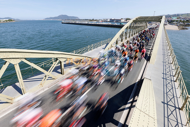 The peloton speed by during Stage 16 of La Vuelta d'Espana 2021, running 180km from Laredo to Santa Cruz de Bezana, Spain. 31st August 2021.     <br /> Picture: Luis Angel Gomez/Photogomezsport | Cyclefile<br /> <br /> All photos usage must carry mandatory copyright credit (© Cyclefile | Luis Angel Gomez/Photogomezsport)