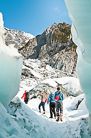 A group of tourists near an ice cave on the Franz Josef Glacier - Westland National Park, West Coast, New Zealand